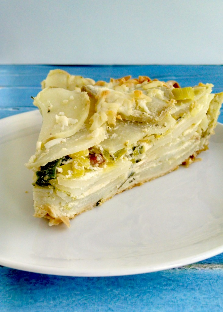 A Kitchen Hoor's Adventures | Potato Leek Pie - A #MeatlessMonday #StPatricksDay Recipe - Just in time for St. Patrick's Day, this tender and flaky pie is filled with hearty potato goodness, subtle leeks, and scrumptious cheese.