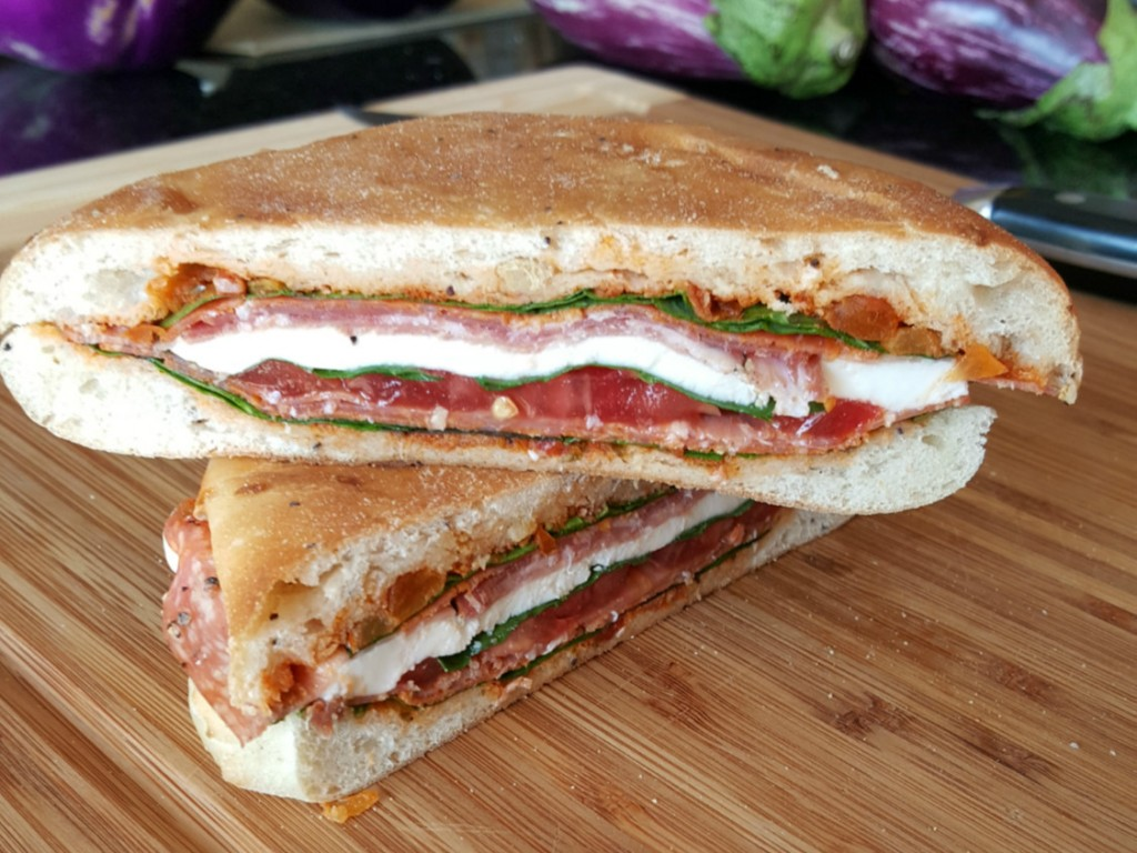 When it's hot in the kitchen, the last thing you want to do is cook!  Whip up some delicious Italian Pressed Sandwiches then kick back with some iced tea while they press; allowing the flavors to meld.