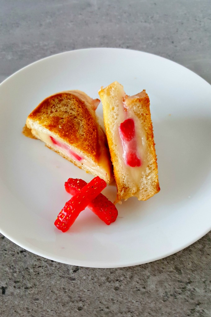 For #FreshTastyValentines I took creamy brie and paired it with luscious strawberries in these mini grilled cheese sandwiches. Strawberry Brie Grilled Cheese Bites are the perfect little snack for your loved one.