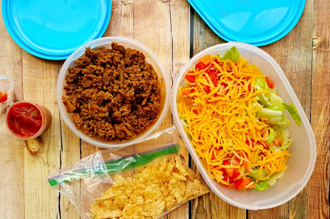 With a little prep and a large bowl of lettuce, you can have your taco salad and eat it, too! This nostalgic Picnic Taco Salad pleases the whole crowd this summer!
