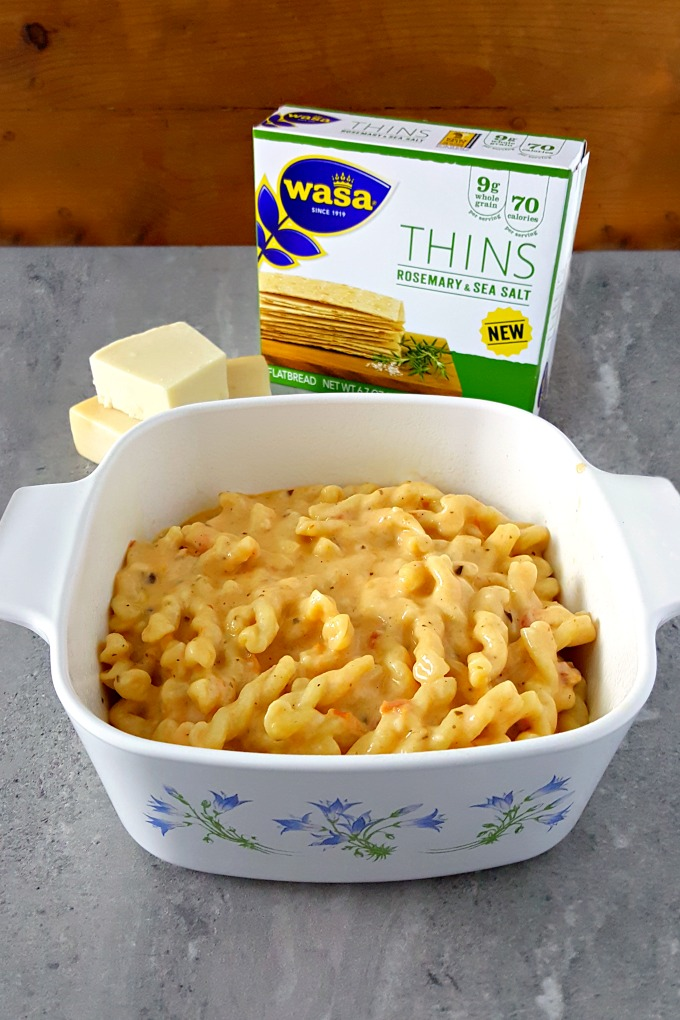 This Sun-Dried Tomato Pesto Four Cheese Macaroni and Cheese with Wasa Rosemary Sea Salt Topping recipe is definitely a mouthful of amazing flavors and textures your family will love for dinner! #HowDoYouWasa #ad