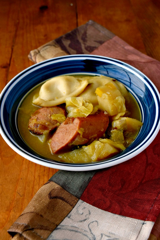 A Dublin coddle is a dish with pork sausage and rashers cooked with potatoes and onions as a stew or soup. My Polish Coddle uses kielbasa, potatoes, and onions topped it with mini pierogies.