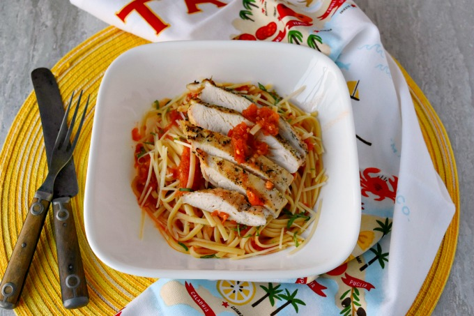 Grating the tomatoes tastes like summer in a sauce. Grilled Chicken and Pasta with Grated Tomato Sauce has a fresh tasting sauce with succulent and delicious grilled chicken.
