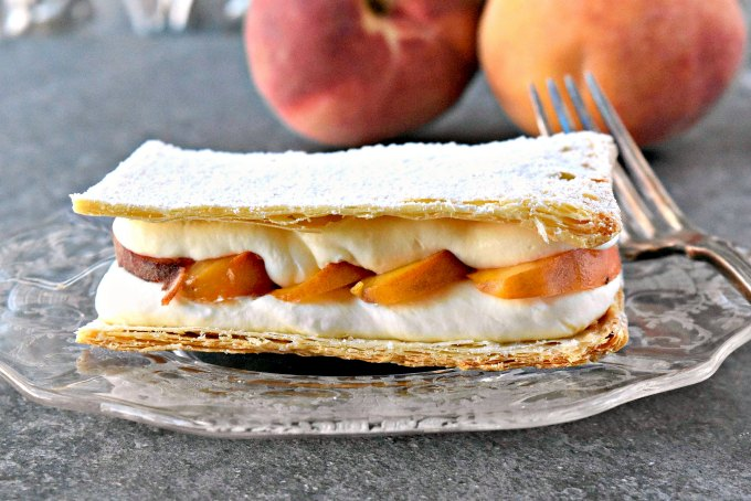 Grilled summer peaches are layered between cream and puff pastry. Grilled Peach Napoleons with Easy Bavarian Cream sounds fancy, but is easy. You can prepare everything ahead of time and assemble right before serving for a perfect barbecue dessert.