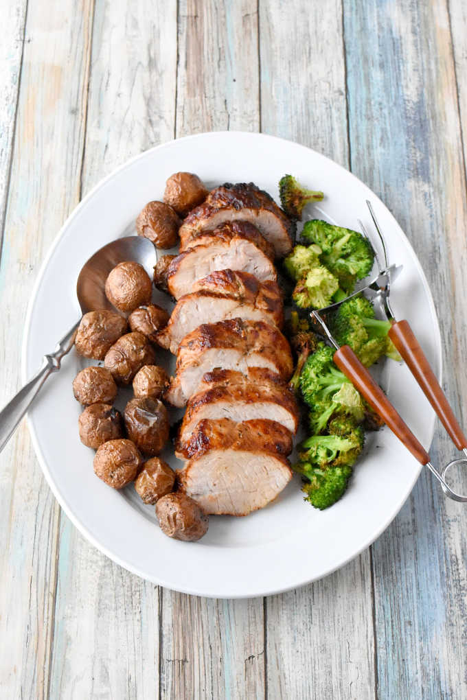 A simple meal of rotisserie roasted pork loin, potatoes, and broccoli all made in the air fryer. Garlic & Herb Rotisserie Pork Dinner is really flavorful and real fast to make. Made with Smithfield® marinated fresh pork, it's our new family favorite!