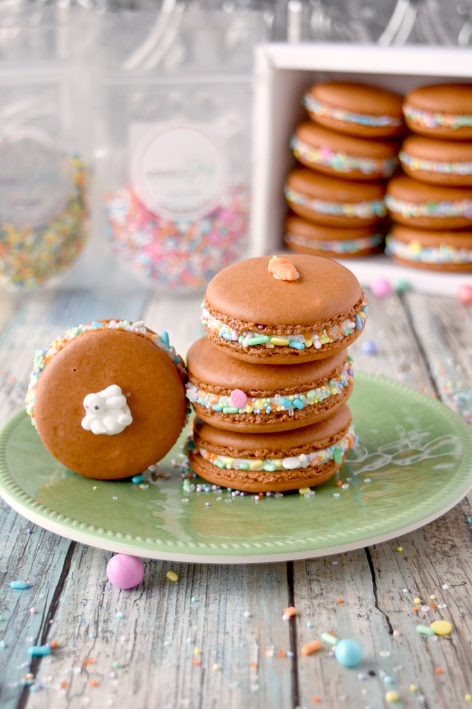 With carrot juice powder and spices in the shells, these Carrot Cake Macaron taste just like a carrot cake! The cream cheese buttercream filling helps bring the flavors home. The sprinkles are just because they're fun! #SpringSweetsWeek