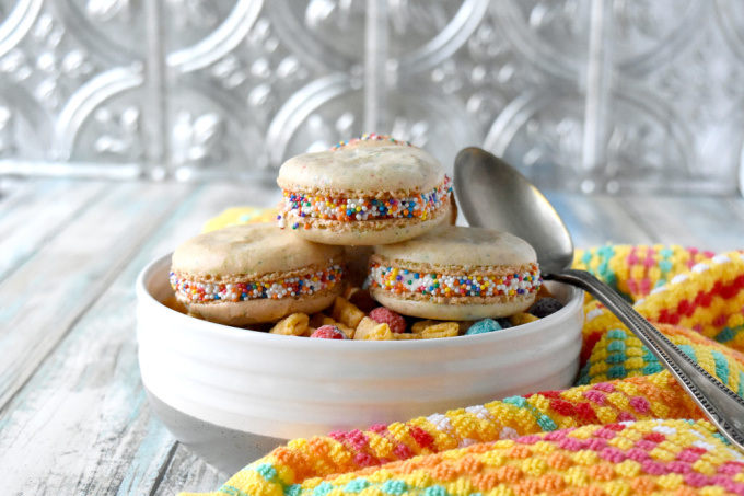 Cereal Milk Macaron taste like your favorite fruit cereal.  There's cereal in the shells and cereal milk in the buttercream.   #BacktoSchoolTreats
