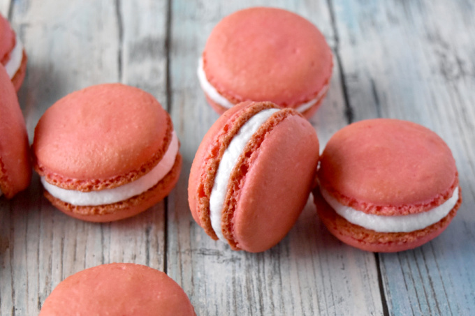 There's a double whammy of peach flavor in these Peach Macaron.  They have freeze dried peaches in the shells and peach syrup in the buttercream.  A bi-fecta of peach flavors. #Stonefruit