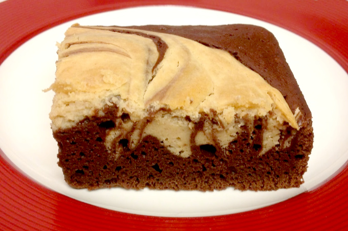 One of my favorite flavor combinations is transformed in this PB Cheesecake Brownie recipe.  With delicious cheesecake, chocolate, and peanut butter flavors, these brownies are sure to please everyone.