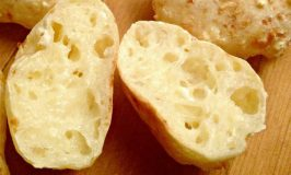 Brazilian Pao de Queijo should be called crack bread. It's like a Yorkshire pudding married a cheese biscuit. It's crispy on the outside and filled with cheesy goodness inside. They're VERY addictive.