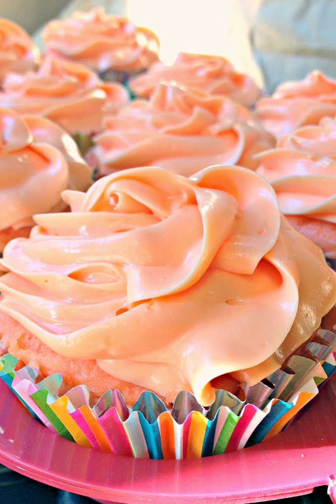 The popular cocktail is turned into these delicious cupcakes.  Tequila Sunrise Cupcakes have delicious orange flavor with a hint of cherry in the cake and tequila in the frosting.