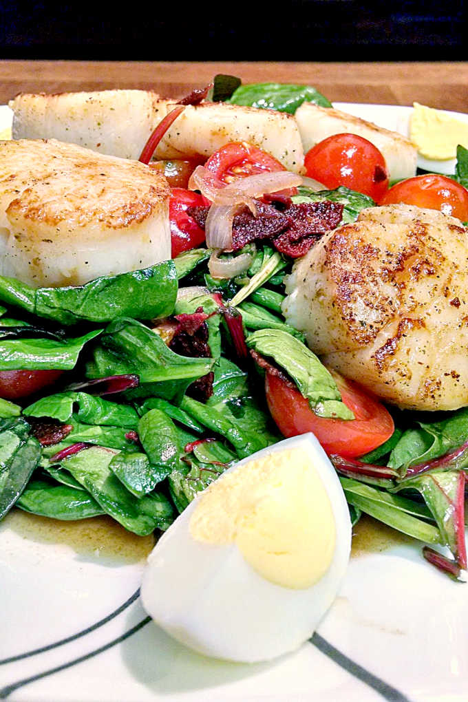 A wilted spinach salad gets a makeover with the addition of pan seared scallops. BLTS Salad has the sweet and sour of the wilted lettuce salad with tangy tomatoes, salty bacon, and sweet scallops. It's a great dinner salad for any night of the week.