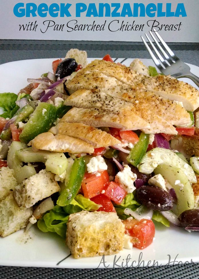 Greek Panzanella with Pan Seared Chicken is amazingly delicious.  It has all the elements of a panzanella salad, but with a Greek twist.