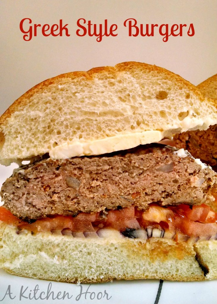 Greek Style Burgers are perfect for Summer grilling! But just look at all that delicious goodness in the burger! The onion, the feta, the tomato pesto. YUM! It all came together perfectly and tasted amazing with the feta on top.
