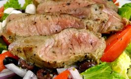 Marked down petite sirloin is the centerpiece in this deliciously simple dinner salad. Steak Caprese Salad is perfect for hot, Summer nights when you don't want to be in the kitchen long.