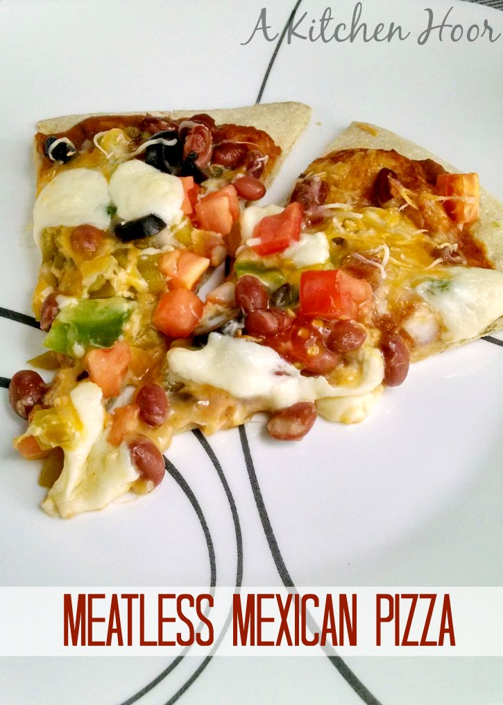 Change up your pizza routine and try this Mexican Pizza!  Not only is it absolutely delicious, but it's meatfree, too!