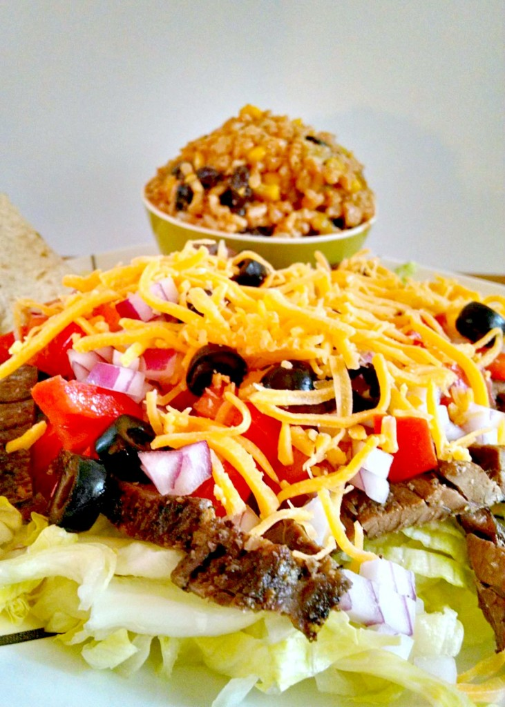 This Asian inspired twist on taco salad is fantastic!! The beef is marinated in a tequila soy mixture then broiled with a salt and pepper coating to make this delicious Salt & Pepper Steak Taco Salad.