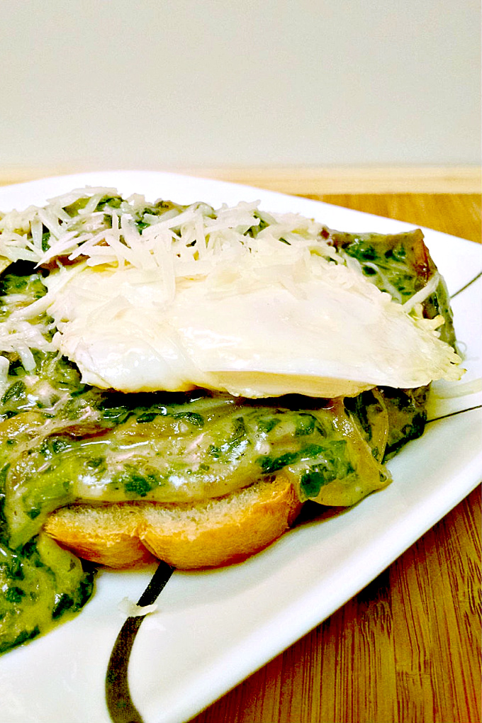 Creamed Chipped Spinach and Mushrooms Over Toast is served over toast with a couple of fried eggs making for a deliciously different breakfast for dinner meal.