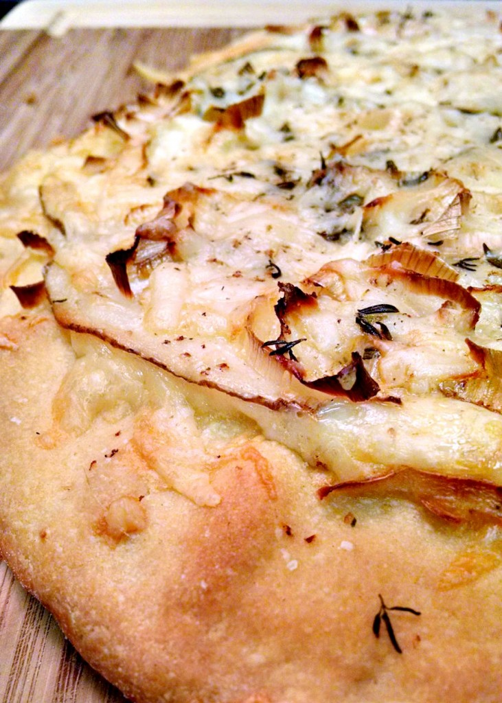 Potatoes and cheese are the centerpiece of this Potato Leek Pizza. It's hearty and delicious for #MealessMonday!