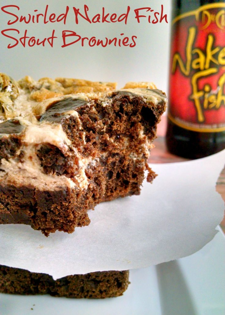 Delicious DuClaw Brewery #NakedFish Chocolate Raspberry Stout is the star in these fudgy, chocolate brownies swirled with raspberry cheesecake topping.  Swirled #NakedFish Stout Brownies will surprise your loved one with their delicious raspberry stout flavor.