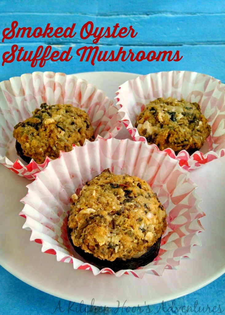#TripleSBites - Smoked Oyster Stuffed Mushrooms - Smoked oysters with red chile is mixed with feta cheese, bread crumbs, and delicious Mekenita Salsa de Casa to make these Smoked Oyster Stuffed Mushrooms.