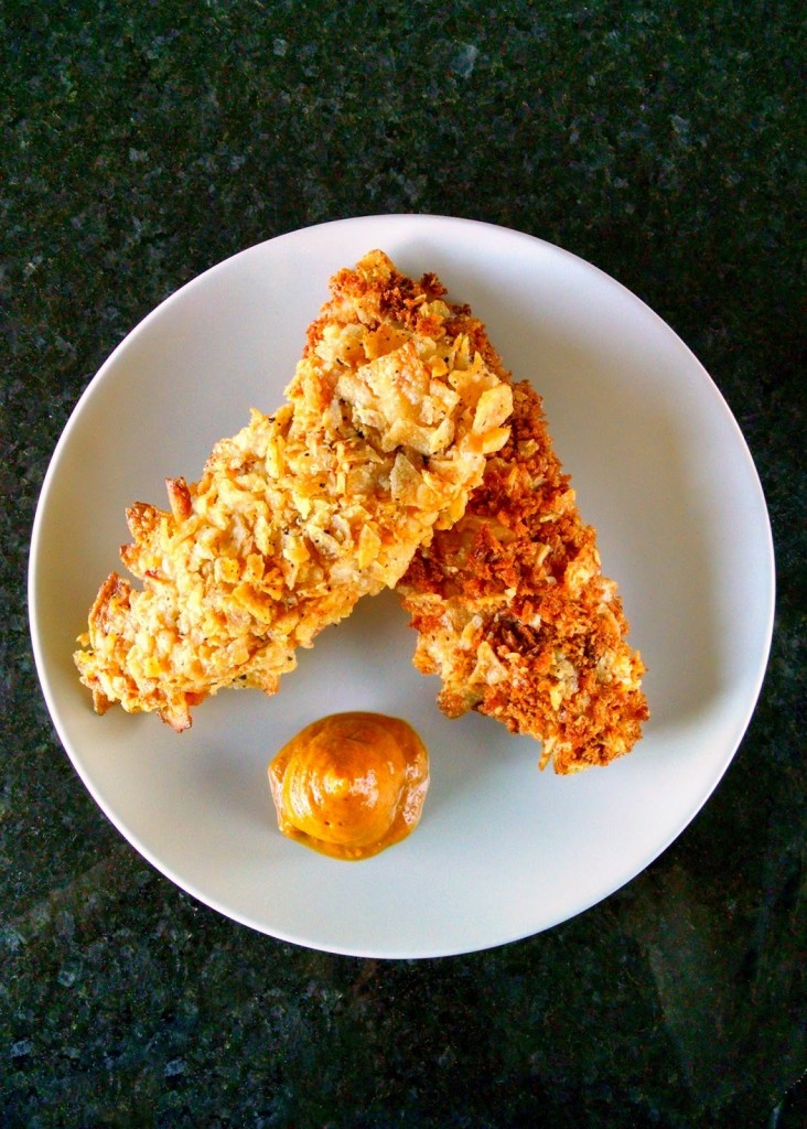 Crunchy potato chips and toasted panko coats tender, juicy chicken strips in these Oven Fried Potato Chicken Tenders! They have epic crunch and amazing flavor.