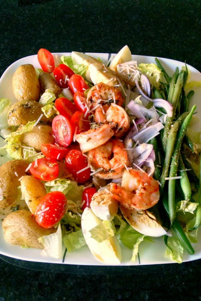 Grilled Shrimp Salad Nicoise is topped with shrimp instead of tuna; making for a delicious twist to this hearty salad.