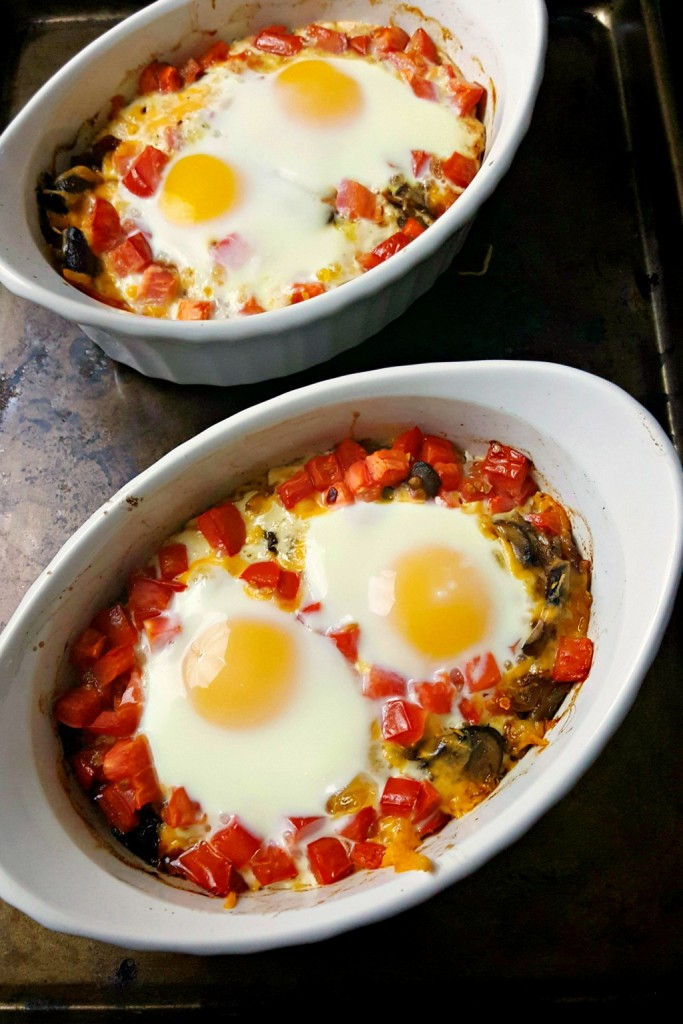 This dish can easily be prepped ahead of time and then it's just a crack of the eggs before baking. These Mushroom Cheddar Baked Eggs are perfect for breakfast, brunch, or a #meatfree dinner.