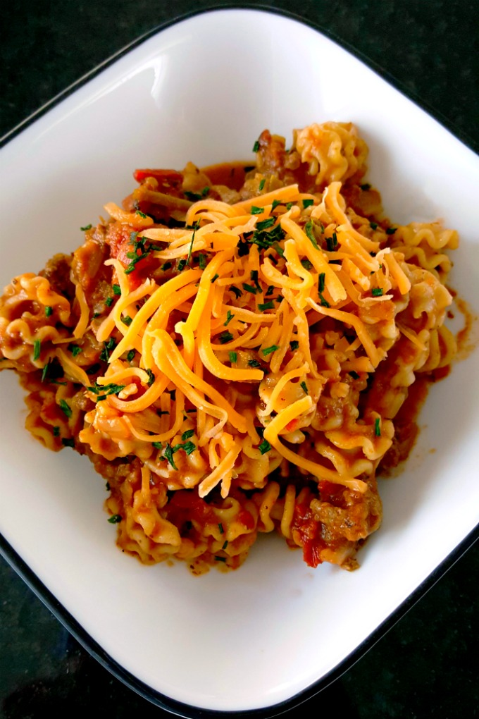 This is even better than my chili mac! This Skillet Taco Pasta is cooked in one pot, tastes like my favorite tacos, and comes together quickly for any night of the week.