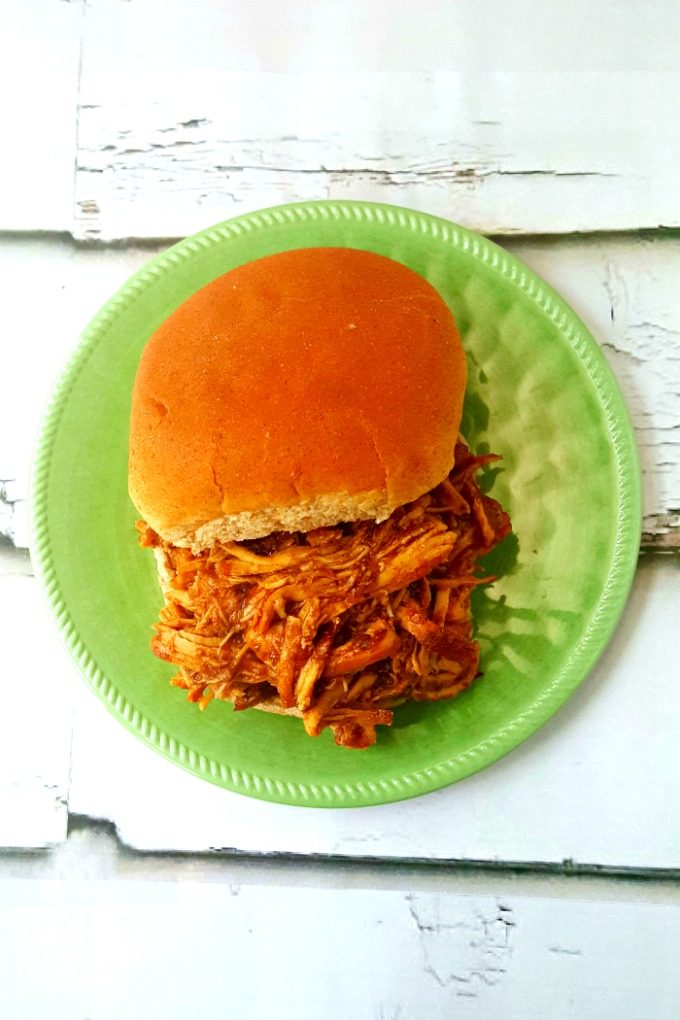 This mango based barbecue sauce has all the delicious flavors of Jamaican Jerk seasoning, but sweetened with delicious mango. Slow Cooker Mango Jerk Chicken Sandwiches taste out of this world!