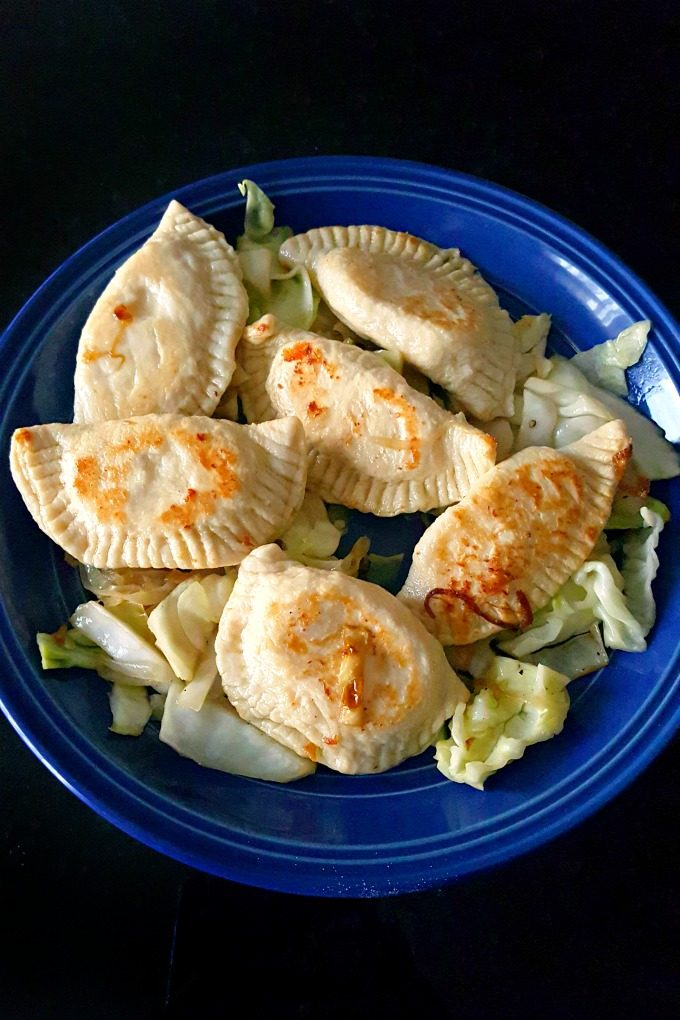 I'm making Mom's Homemade Perogies. It's a family recipe that is tender, tasty, tangy, and delicious! I've filled them with potatoes and extra sharp cheddar cheese.