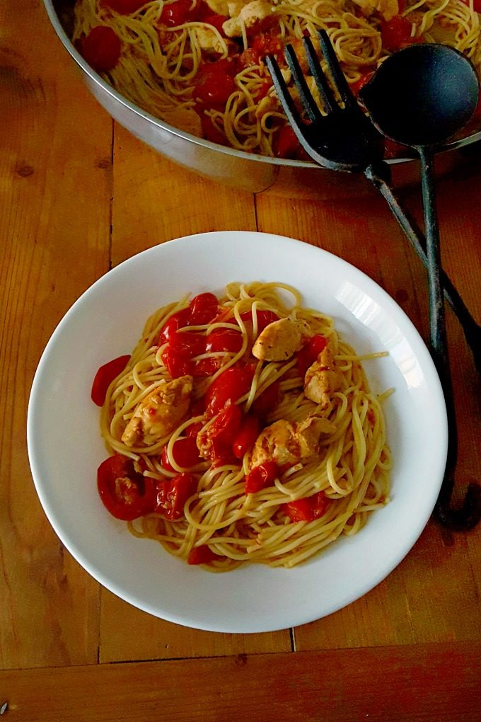 This Blistered Tomato Pasta with Chicken is simple yet packed with complex flavors. It's perfect for a weeknight or a dinner for guests.