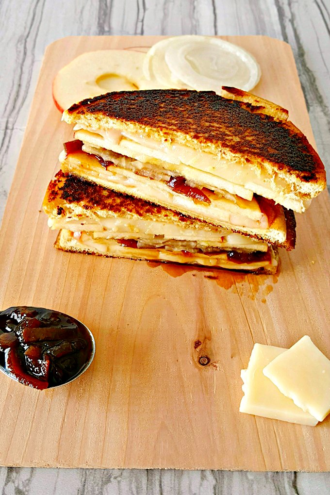 Apple Cheddar Grilled Cheese is fall in a grilled cheese. It has crisp and crunchy apples, sharp and creamy cheddar, and sweet and delicious caramelized onions.