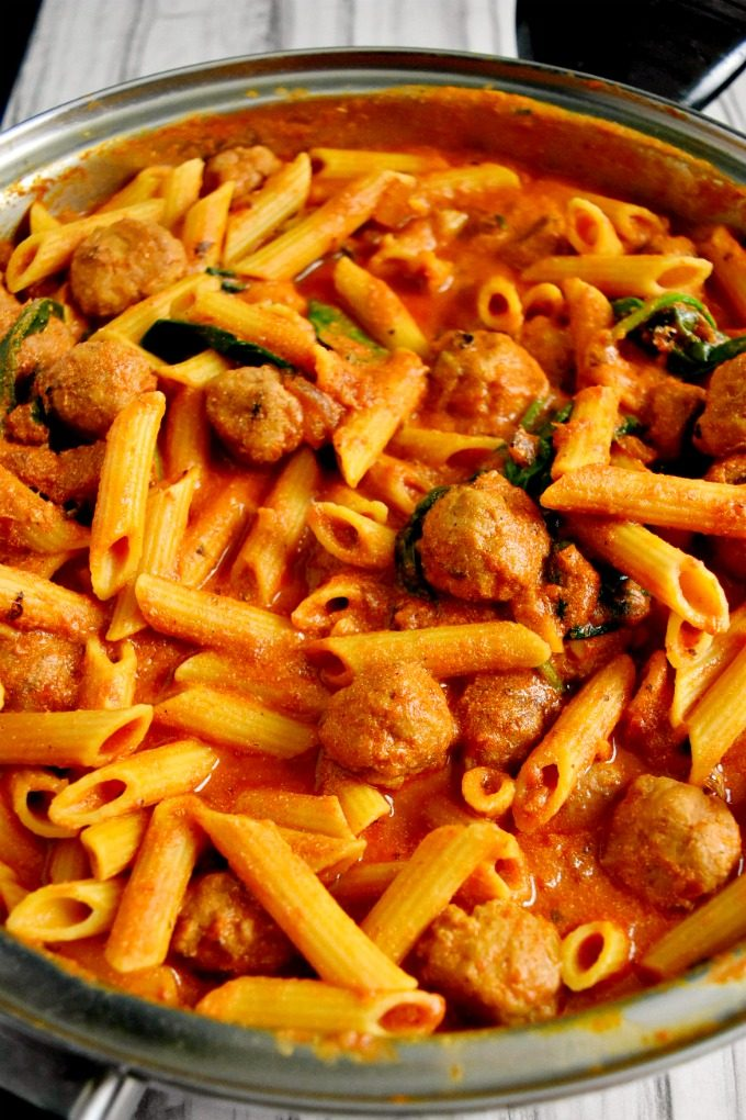 Italian sausage is simmered with a simple marinara and cream sauce. Fresh spinach is added at the end to finish off this new family favorite recipe. Your family will ask for Italian Sausage Pasta every week!!