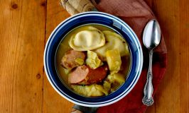 An Irish coddle is a dish with pork sausage and rashers cooked with potatoes and onions as a stew or soup. My Polish Coddle uses kielbasa, potatoes, and onions topped it with mini pierogies.