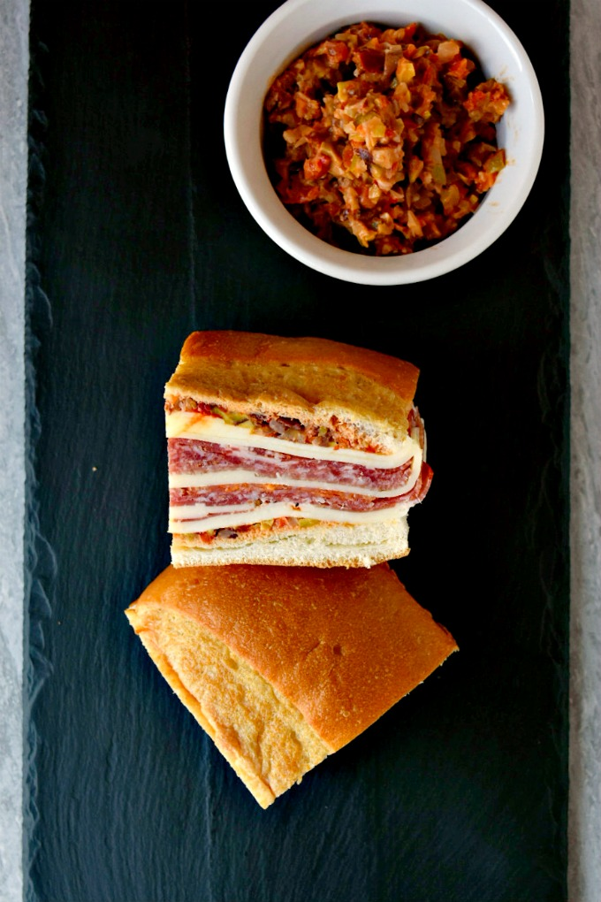 This is a muffaletta you could easy make for a crowd or a picnic. Overnight Muffaletta Sandwich is quick to make but tastes oh so delicious! Laissez les bons temps rouler!!