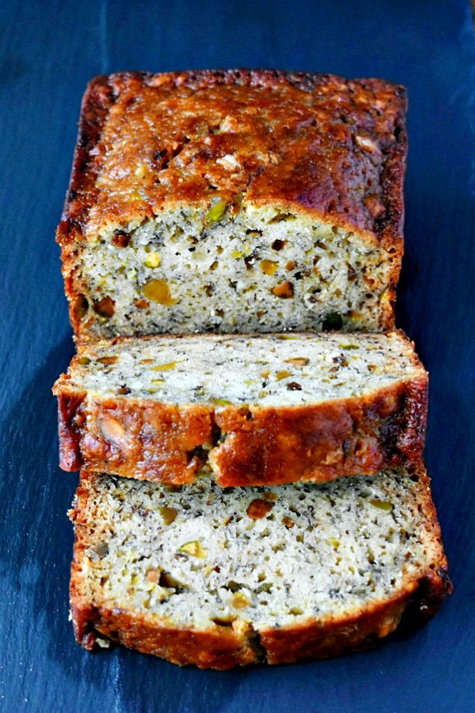 Bourbon Banana Bread with Pistachios has hints of bourbon through with the crunch of pistachio and sweet bananas. Bake and take because it's too dangerous to keep at home! #FreakyFriday