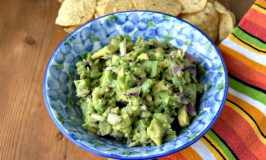 The sweet kiwi and the creamy avocado pair well with the jalapeno in this delicious guacamole. Kiwi Guacamole is addictively delicious and perfect for summer nibbles.