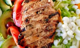 I basted chicken breasts in white barbecue sauce and grilled before slicing and topping this Alabama Cobb Salad. Don't let this white barbecue sauce fool you! It's got a kick!