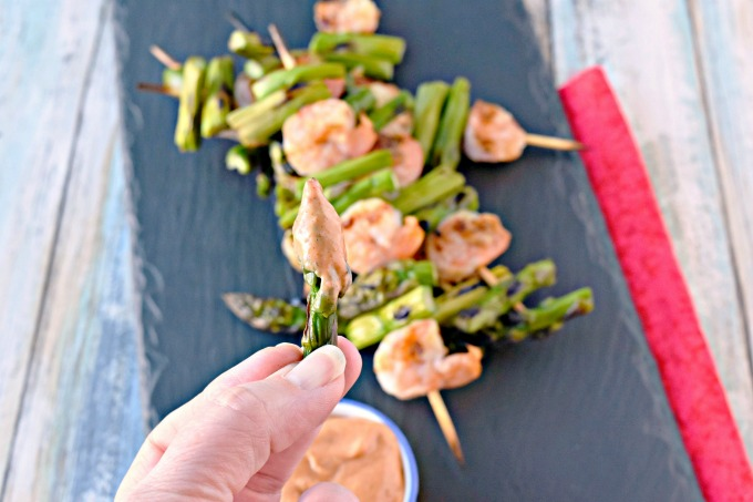 A quick and easy grilled dinner, Grilled Shrimp and Asparagus with Bang Bang Sauce is packed with flavor and a kick.