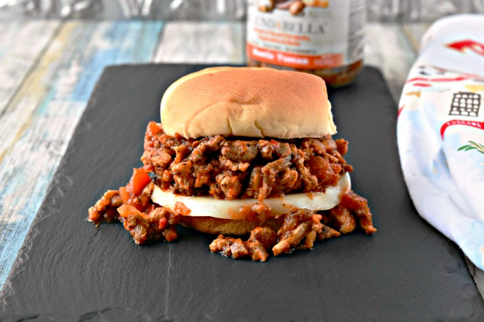 BLENDABELLA Rustic Tuscan Portobello blend combined with farmers market fresh ground chicken make for an amazingly quick and DE-licious weeknight dinner.  The complex flavors in these Tuscan Chicken Sloppy Joes can be serve for any night of the week.  They're great on buns for your family or on top of lettuce for guest worthy appetizers.