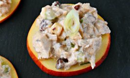 Savory and sweet chicken salad sits on top of apple slices for a delicious and quick appetizer.  Chicken Salad Apple Bites are a perfect afternoon snack, easy appetizer, or quick nibble before dinner. #AppleWeek