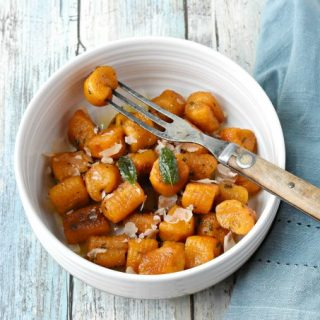 Pillows of pumpkin goodness make Pumpkin Gnocchi with Sage Butter Sauce a truly flavorful pasta dinner. Add some sausage for a more hearty dinner for your family. #PumpkingWeek