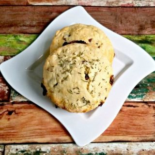 Cranberry White Chocolate Rosemary Scones are packed with flavor, as you imagine.  The tart, dried cranberries are offset by the slightly sweet flavor of the white chocolate and touch of sugar in these scones.  The unexpected rosemary is not overpowering and truly makes these smell and taste amazing.