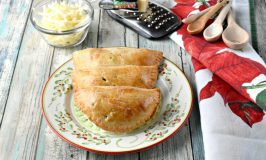 Dad always had sharp cheddar cheese with his apple pie.  I added Cabot Vermont sharp cheddar to the crust of these Apple Cheddar Hand Pies.  Not only do the smell amazing while baking, but taste scrumptious warm from the oven. #ChristmasSweetsWeek