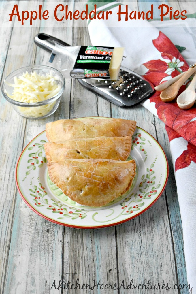 Dad always had sharp cheddar cheese with his apple pie. I added Cabot Vermont sharp cheddar to the crust of these Apple CheddarHand Pies. Not only do the smell amazing while baking, but taste scrumptious warm from the oven. #ChristmasSweetsWeek