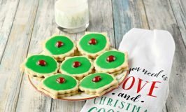 Buttery cookies are filled with jam and topped with icing and a cherry. Empire Biscuits are a traditional Scottish holiday cookie that taste delicate and delicious.
