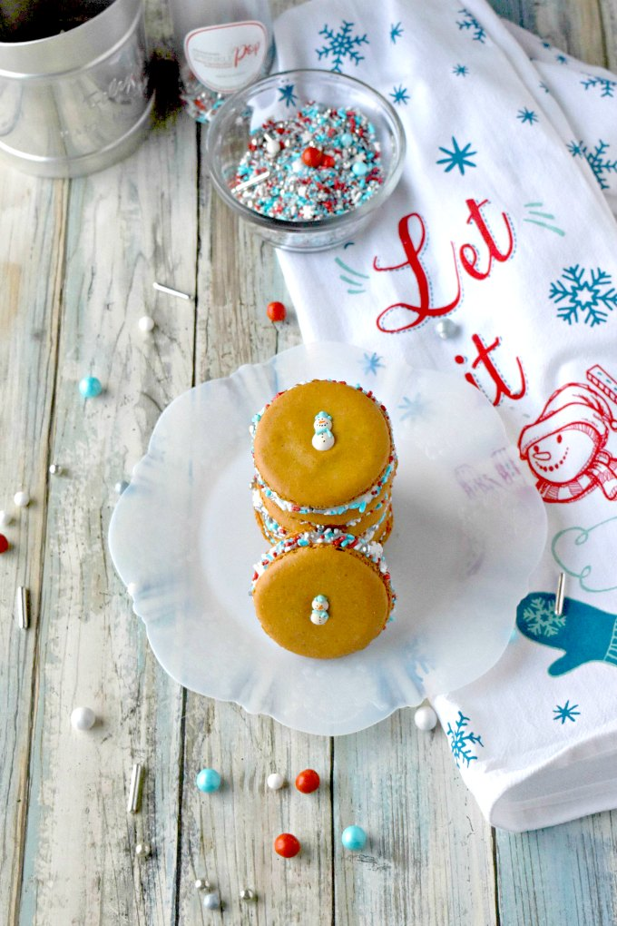 Perfectly delicious and packed with amazing gingerbread flavor, these Gingerbread Macaron have the best cream cheese buttercream filling. The combination of flavors and cute Sprinkle Pop decorations make these irresistible!