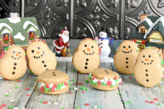 Coconut in shells and almond extract in the buttercream make these Snowmen Macaron taste like an almond joy! It wouldn't be a blogging event if I didn't make my favorite cookie.