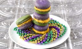 Bananas Foster Macaron are a party in your mouth!  With banana shells and salted caramel with rum in the buttercream, these macaron taste just like #MardiGras.